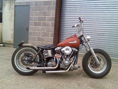 Simple, bare-bones shovel-head bobber from boneshaker choppers. No extra bling, just a stripped back original with a some new wheels, guards and bars. Nice.