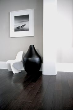 This extremely reduced palette and dark hardwood floor provide a focused, somewhat stoic mood.