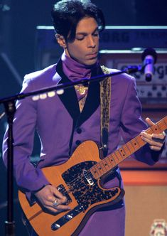 Prince's 15 Most Iconic Purple Outfits - June 27, 2006 from InStyle.com - Prince performed onstage at the 2006 BET Awards in a stylish grape-colored ensemble.