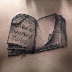 Greyscale book tattoo