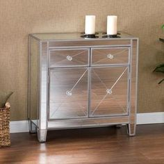 @Overstock.com - A mirrored finish and practical size highlight this media stand which features 2 drawers and large double door storage cabinet with faux crystal knobs. $235 / rave reviews from buyers of this piece; the style is called Hollywood Regency