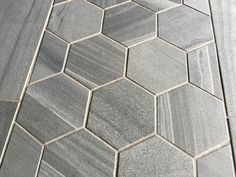 An example of hexagon tile in a large format tile in a wood-like concrete look