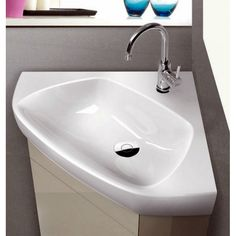 This corner sink might be the solution to lack of space in my small bathroom