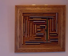 A sculpture made of oak and poplar. This modern piece was found by Jenna in Indianapolis. She liked the sense of being a painting, it was 3-D. The shadows and depth give the piece an eerie quality. The subtle touches of paint play tricks on the eyes and mind. She appreciates its dynamic quality.