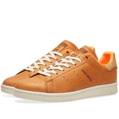 First debuting in 1971 as a tennis all-star sneaker, the adidas Stan Smith has defined itself as today's streetwear legend. This classic court show is reimagined with Horween leather uppers from the heritage American tannery. A luxurious spin on an archival look, the same clean lines are set on the original '70s cupsole with a leather heel patch that rounds off the look.     Leather Uppers Horween Tannery Leather Lining  OrthoLite® Sockliner  Perforated 3-Stripes Rubber Cupsole Style Code…