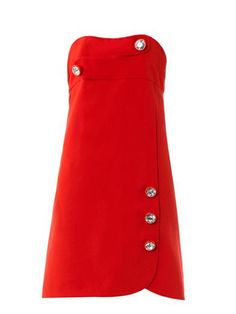 Christopher Kane's scarlet wool-crepe dress is a quick-fire way to amplify your cocktail collection. It features a cross-over bust detail and Swarovski crystal buttons – a recurring detail for the London-based brand.