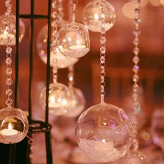 Glass globes infused with crystals and glowing candles // The Wedding Central HD Video and Photography