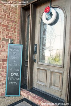 Winter ONEderland Party! Turn a $5 mirror into a chalkboard to greet guests at the door.