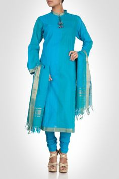 Accentuate your look with this straight fit blue cotton kurta all over embellished with pin tucks. Teamed with cotton churidaar and cotton kota dupatta, this kurta is a beautiful choice.