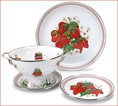 Golden Rabbit Strawberry Enamelware: Porcelain enamel dinnerware in a cheerful strawberry motif is vastly superior to typical tin plates. Colorful and classic, enamelware is at home in a country kitchen or striking in a high style setting. From oven to table to the dishwasher, enamelware from Golden Rabbit is fully functional without forgetting the fun. Made in Indonesia.