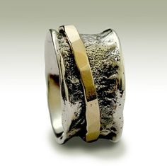 sterling hammered band with gold spinner