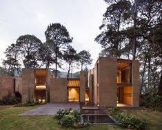 The house is composed of six volumes laid out to create a void in the center. Tagged: Exterior, Brick Siding Material, House, and Flat RoofLine.  Photo 5 of 17 in Five Cubist Hideaways Peek Out From a Mexican Pine Forest