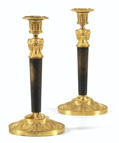 A PAIR OF PATINATED AND GILTBRONZE CANDLESTICKS, EMPIRE