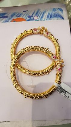 Beautiful 40 grms gold bangle studded with kundans and emeralds. Beautiful bangle with hand crafted nakshi work. 11 April 2018