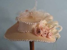 Dollhouse miniature 1:12 scale hats are all original, named and numbered.    This blush satin hat is trimmed with bunka, silk ribbon roses, silk