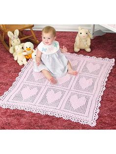 Solid-stitch hearts framed in lacy filet squares create a beautiful baby blanket that is sure to become a cherished family heirloom. Includes written instructions only. This e-pattern was originally published in the February 2016 issue of Crochet World magazine.