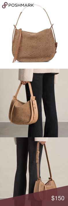 {all saints} mini echo star embossed leather bag All Saints Mini Echo Star Embossed Convertible Bag. Calling all street-style stars: this heavenly calfskin bag is the perfect way to pull together your ensemble and make it shine. Top zip closure Optional, adjustable strap. Can be worn two ways. Interior zip pocket Lined Calfskin leather Imported  Brand new with tags. All Saints Bags Mini Bags