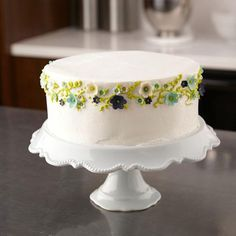 Party Cake With Fondant Flowers.  Use the Wilton Flower and Leaf Mini Fondant Cut-Outs Set to quickly and easily cut out perfectly shaped blossoms. The flowers can be randomly attached to the top edge of a cake with dots of icing.