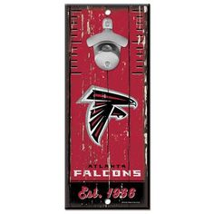 A classic retro fan cave essential. The inch hardboard sign has a tough cast opener securely attached, and two mounting holes are drilled for easy hanging. Made in the USA by Wincraft. Retro Fan, Wall Mounted Bottle Opener, Atlanta Falcons, Cool Bars, Wooden Walls, Wooden Signs, Nfl, Sports Signs, Bottle Openers
