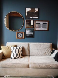 Sheena's Converted Warehouse Apartment in DUMBO: inspiration for above the mantle, circle mirror + frames