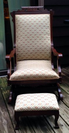 Antique Victorian Eastlake Rocking Chair with platform springs and original wood castors