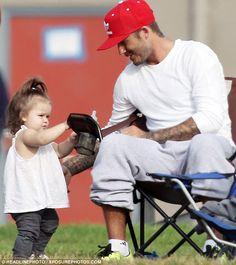 : Photo David Beckham gives his adorable daughter Harper a kiss while watching his boys play soccer on Saturday (September in Los Angeles. David Beckham Photos, David Et Victoria Beckham, Victoria And David, Posh And Becks, The Beckham Family, Harper Beckham, Bend It Like Beckham, Super Dad, Play Soccer