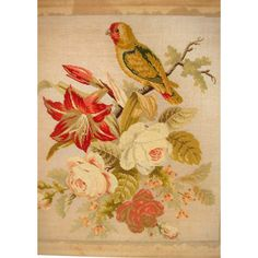 Large antique needle work of a parrot and flowers dating from about 1860.  It is well worked and would look lovely framed up.  It is nicely worked and