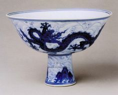 A painted anhua-decorated blue and white 'dragon' stem bowl, Xuande six-character mark in underglaze blue within a double circle and of the period (1426-1435). Collection of the Palace Museum, Beijing.