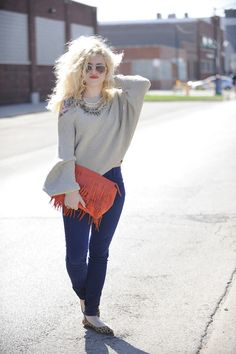 Love the ease of this look and the adorable orange clutch.