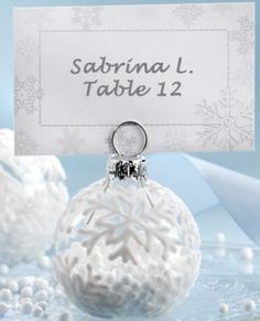 Super cute flocked ornament place card holders for Winter weddings!