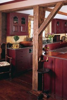 Company I like the dark red cabinets with the light walls. The exposed beams and dark wood floors are nice, too.I like the dark red cabinets with the light walls. The exposed beams and dark wood floors are nice, too. Country Stil, Country Farmhouse, Farmhouse Decor, Rustic Kitchen Cabinets, Kitchen Rustic, Kitchen Ideas, Kitchen Colors, Red Kitchen Walls, Kitchen Decor