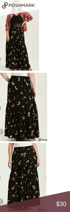 Torrid Floral Print Maxi Skirt Black challis (it's like the silkiest, airiest, stretchiest fabric ever) gets country-fied on this maxi skirt with a floral print. Buttons detail the front, lending just a touch of structure, while the billowy hem is all about flow. The stretch waistband keeps the look comfier than ever. Brand NEW, Tags Still Attached, Size 18. torrid Skirts Maxi