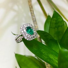 Turn your friends green with envy this this shimmering green emerald and diamond ring