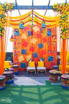 Colourful mehndi decor idea with kites in photobooth
