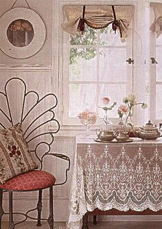 beautiful lace tablecloth and silver. Not normally a fan of so much white, but lace always wins the beauty race with me