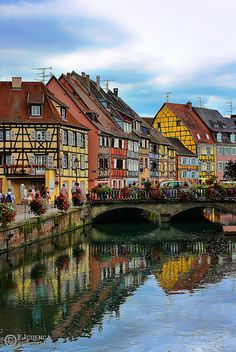 Colorful Houses in Colmar, France.  I would love to go here!  The town in Howl's Moving Castle was inspired by Colmar!