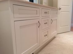 A new home in Sherborn, Massachusetts. Matt Desmond, a designer at Oceanside Cabinets (a StarMark Cabinetry dealer in Marblehead, Mass), specified StarMark's Fairhaven inset door in Maple finished in an off white color called Marshmallow Cream. The drawers have optional five piece headers.