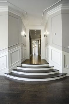 Lane Myers Construction Custom Home Builder Loeffler Residence Draper Utah Versailles Inspired Ballroom Entryway Hardwood Dark Floors Gray Walls White Trim