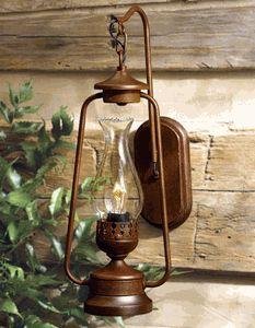 "LANTERN. General use. Rustic Lantern Wall Sconce. $150. 8""W x 8""D x 18""H."