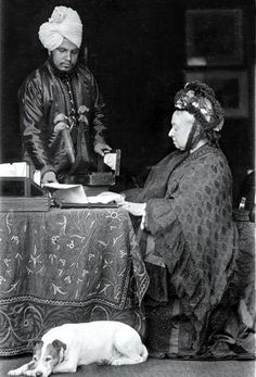 Queen Victoria and her Indian secretary, Abdul Karim, c.1890. Abdul Karim, also known as The Munshi, was Queen Victoria's favourite servant later in life. Photo taken at Balmoral.