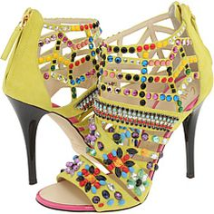 Yellow is one of the best base colors for embellishment. Also, these are nuts. (Giuseppe Zanotti)