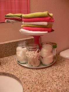 Bathroom idea- cake stand to organize