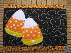 Halloween mug rug quilted with glow in the dark thread!