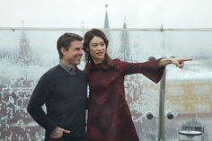 Hollywood actor Tom Cruise, left, and actress Olga Kurylenko pose during a photo call to promote their new movie Oblivion on the roof of a hotel in Moscow, with the Kremlin in the background, Monday, April 1, 2013. (AP Photo/Ivan Sekretarev)