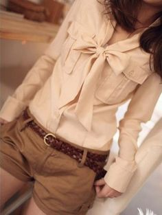 Cute ribbon beige shirt with the camel colored shorts and the brown belt.