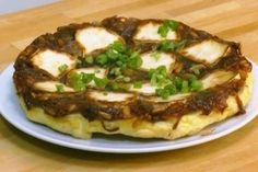 Découvrez cette recette de Tarte tatin d'oignons et chèvre frais expliquée par nos chefs