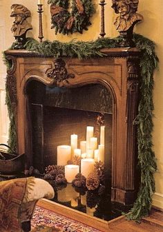 <3 the candles in the fireplace with pinecones
