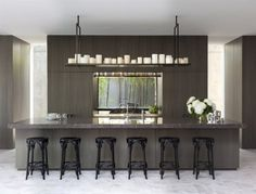 linear layout...dining space behind service wall