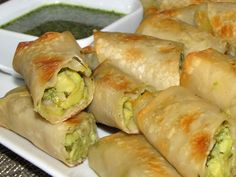 Avocado egg rolls Avocado Mix:  3 avocados  3 TB red onion, thinly sliced  2 TB chopped cilantro  1 garlic clove, mashed  1/2 tsp salt  2 TB lime juice  Dipping  Sauce:  1/2 c cilantro chopped  1/4 c honey  1 1/2 TB white vinegar  1 garlic clove minced  1/2 TB olive oil  pinch turmeric   pinch salt  1/2 tsp lime juice    12 eggroll wrappers
