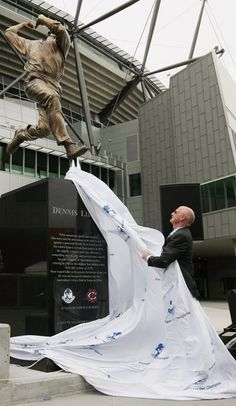Former Australian cricketer Dennis Lillee unveils a statue of himself which was unveiled as part of the Walk of the Champions at the Melbourne Cricket Ground December 22, 2006 in Melbourne, Australia.